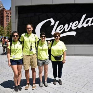 A group of students in front of a sign that says Cleveland